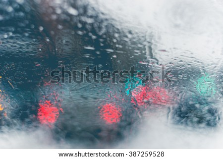 Road view through car window with rain drops and melting snow, Driving during snow storm in Montreal - stock photo