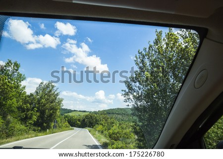 Road viewed from the window of a car, Volterra, Province of Pisa, Tuscany, Italy