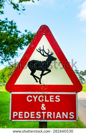 Road Warning Signs - Deer, Cycles and Pedestrians, England, UK - stock photo