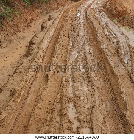 road wet muddy of countryside - stock photo