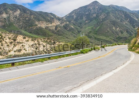 Road winds through national forest mountains above Los Angeles, California - stock photo