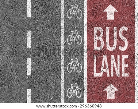 Road with bicycle lane and bus lane marks  - stock photo