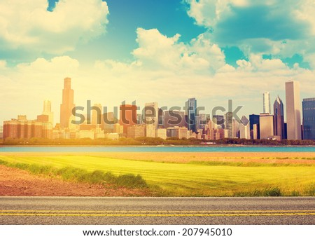Road with blurred city panorama on horizon  - stock photo