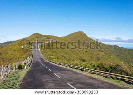 Road with fence and blue sky at Paul da Serra high plateau, Madeira, Portugal