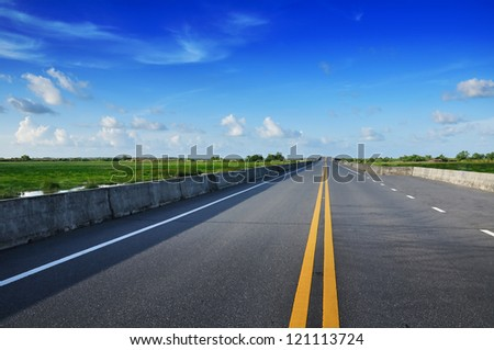 Road With Painted Double Yellow Line - stock photo