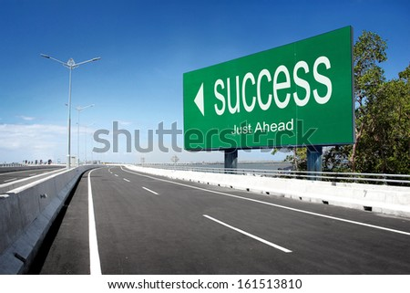 road with sign of success. conceptual image - stock photo
