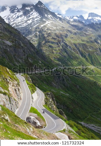 road with tight bends at Susten pass in high alpine Mountains, Switzerland - stock photo