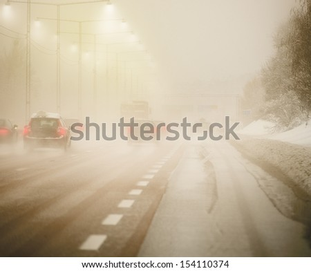 Road with traffic and heavy fog - stock photo