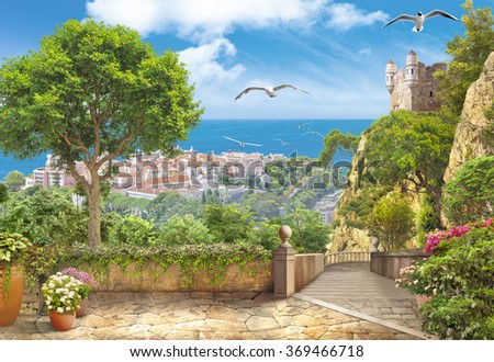 Road with views of the city and the sea - stock photo