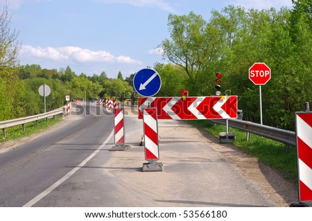 Road work, detour and road construction signs - stock photo
