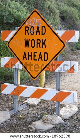 Road work sign with graffiti on it