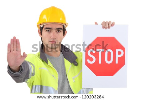road worker holding a stop sign - stock photo