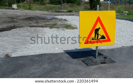 Road works sign for construction works in street