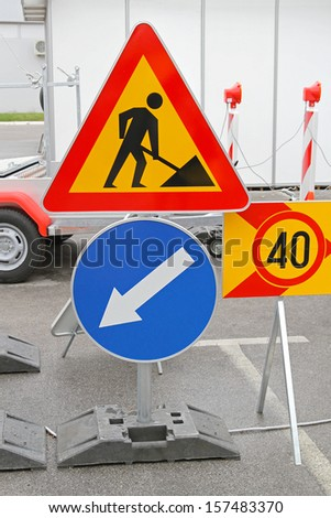 Road works traffic sign and direction arrow