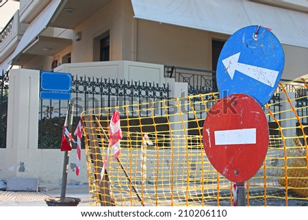 "Road works. Warning signs ""Do not enter"" and ""Detour"" in a street - stock photo"