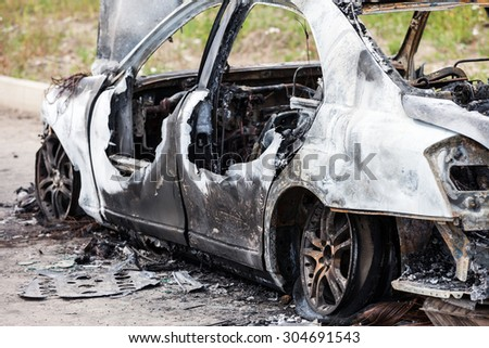 Road wreck accident or arson fire burnt wheel car vehicle junk