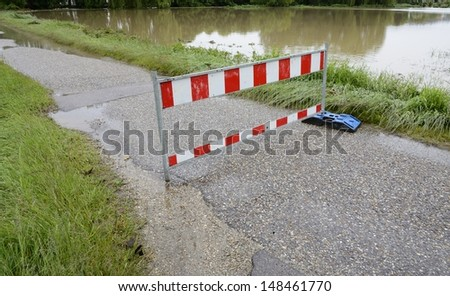 Roadblock because of flooding after heavy rain - stock photo