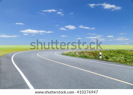 Roads Curve with green grass blue sky and cloud background