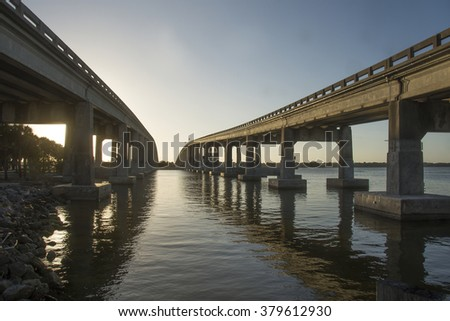 Roads over River/Two Bridges/Sunset falls on two freeways at Meritt Island Florida  - stock photo