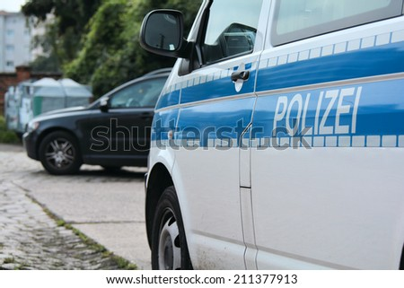 roadside parked police car while a police operation in the city of Magdeburg