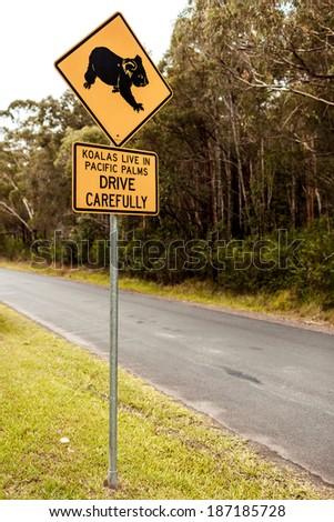 Roadside sign warning of Koalas being in area - stock photo