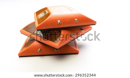 Roadside vehicle breakdown or construction hazard light or danger caution emergency lamp. Concept of road safety tool. Isolated on white background. Slightly de-focused and close-up shot. Copy space. - stock photo
