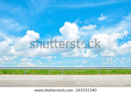 Roadside view of beautiful blue sky as natural background - soft focus - stock photo