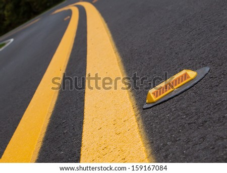 Roadway devider lines and markers - stock photo