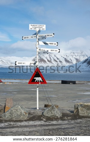 Roadway signpost in longyearbyen svalbard norway with polar bear warning - stock photo