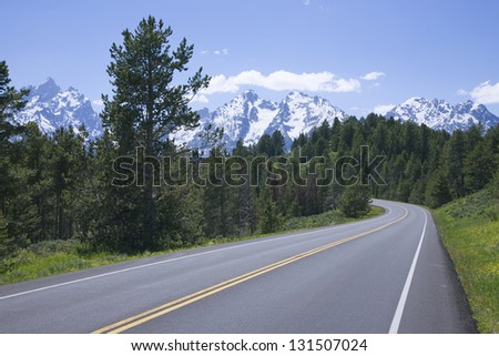 Roadway to Grand Tetons, Wyoming, USE - stock photo