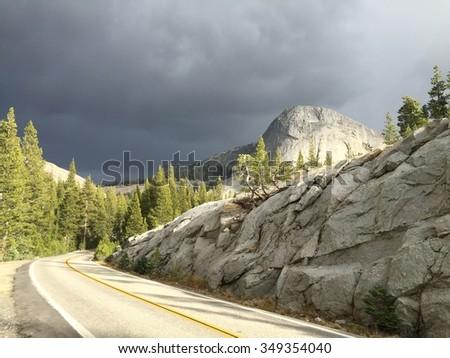 Roadway winding around Granite Mountains in Yosemite National Park California - stock photo