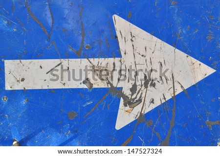 Roadworks, road sign, white arrow on blue background - stock photo