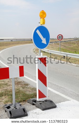 Roadworks, road signs in a highway on reconstruction