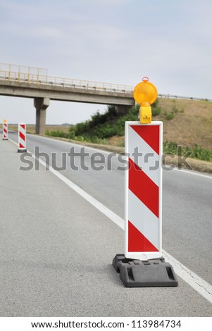 Roadworks, road signs in a highway on reconstruction - stock photo