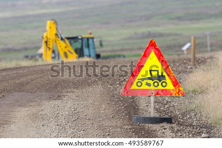 Roadworks sign, bright yellow and red - Iceland