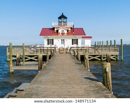 Roanoke Marshes Light, in the harbor at Manteo, North Carolina, is a replica of the  screw-pile  lighthouse that was originally located several miles south near the community of Wanchese. - stock photo