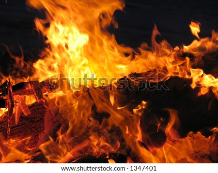 Roaring hot red flames with glowing burning embers - stock photo