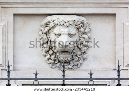 Roaring Lion Head High-relief on the Facade of a Palace - stock photo