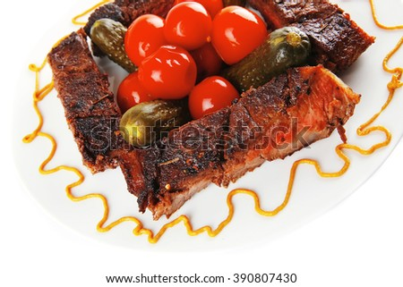 roast beef meat steak with cherry tomatoes and salted cucumbers on white plate isolated over white background - stock photo