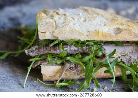 Roast beef, rocket and horseradish sandwich - stock photo