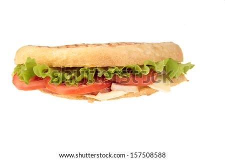 Roast beef sandwich with lettuce, tomatoes, cucumbers and radishes isolated on white - stock photo
