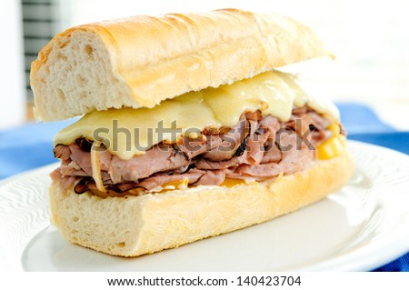 roast beef sandwich with swiss cheese and heirloom tomatoes - stock photo