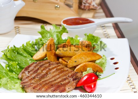 Roast beef with fries and tomato on white plate