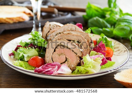 Roast beef with pesto and salad.