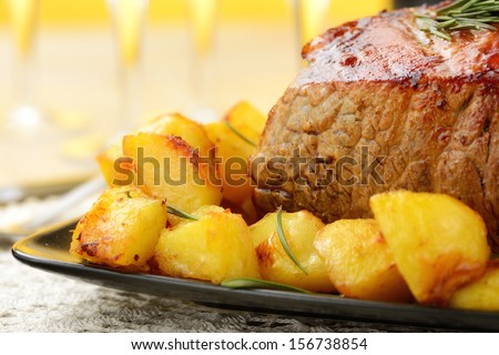 roast beef with potatoes - stock photo