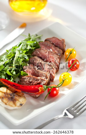 Roast Beef with Vegetables and Rocket Salad - stock photo