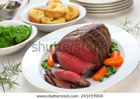 roast beef with yorkshire pudding, sunday dinner - stock photo
