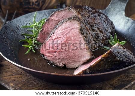 Roast Boar Neck in Frying Pan - stock photo