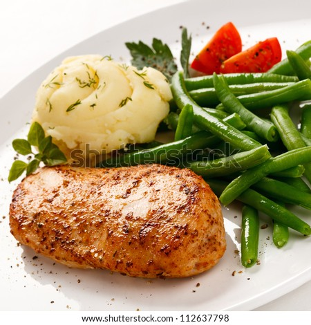 Roast chicken breast, mashed potatoes and green beans - stock photo
