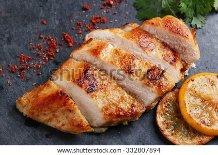 roast chicken breast with lemon and vegetables - stock photo